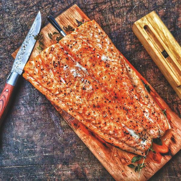 Planked salmon in a wood-fired oven